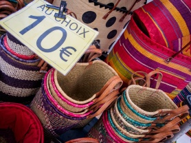 Woven baskets on display at the Marché Raspail open air market, Paris, France