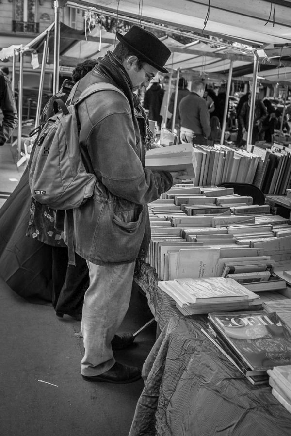 A man looking at old books