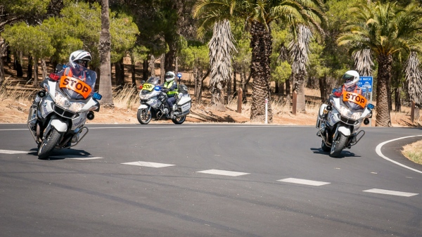 Police motorcycle officers enforcing rolling road closures during Stage 1 of  the 2014 SANTOS Tour Down Under in the Barossa Valley in South Australia